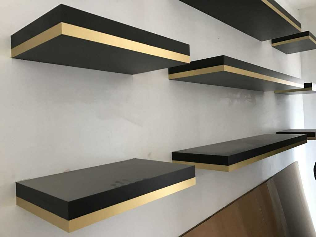 ebony-stained-floating-shelves-with-brass-detail-design