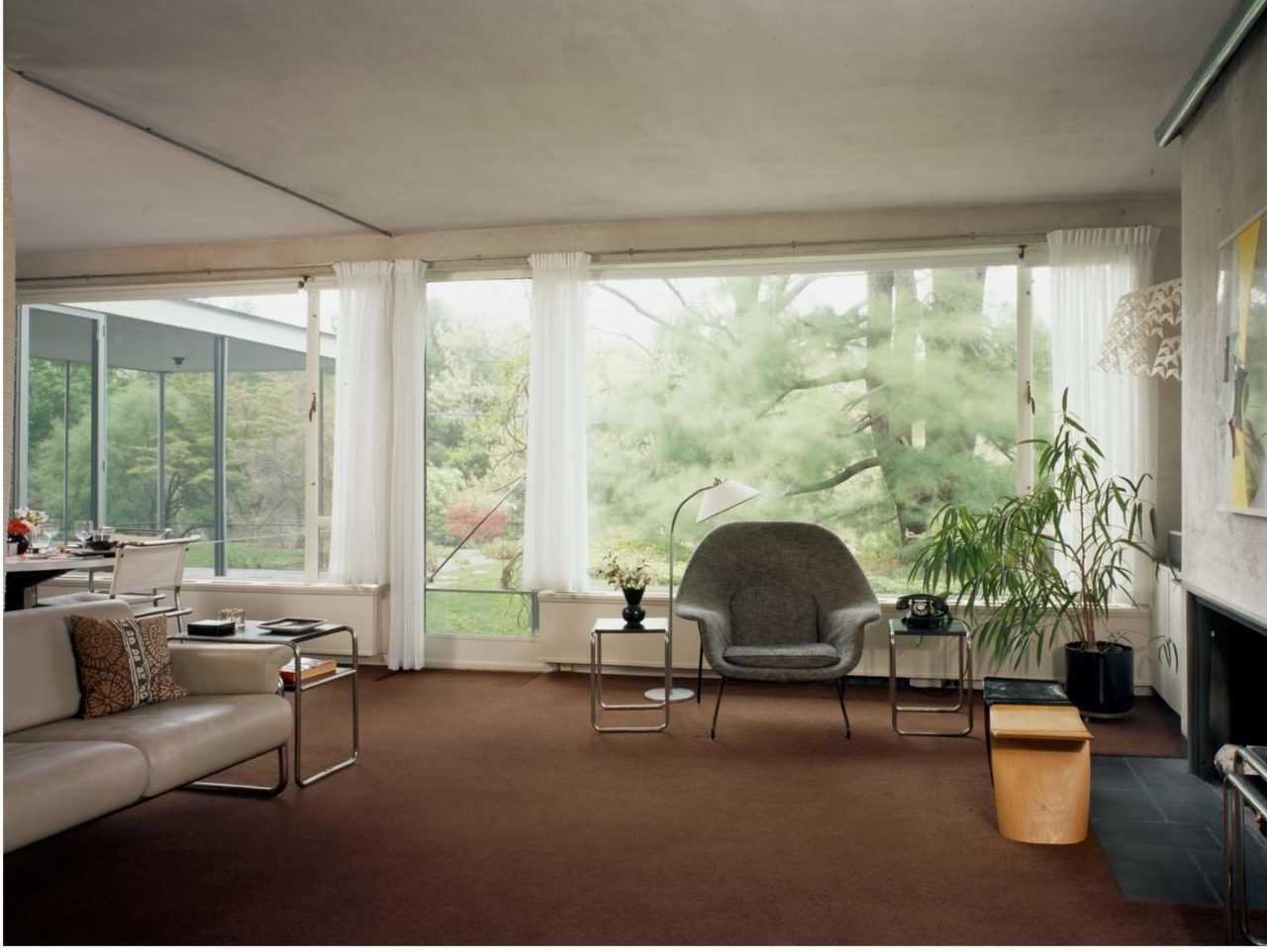 Bauhaus furnishings, oversized windows and an open floor plan could feel stark and austere, yet at the Gropius House the living and dining areas feel cozy and personal.