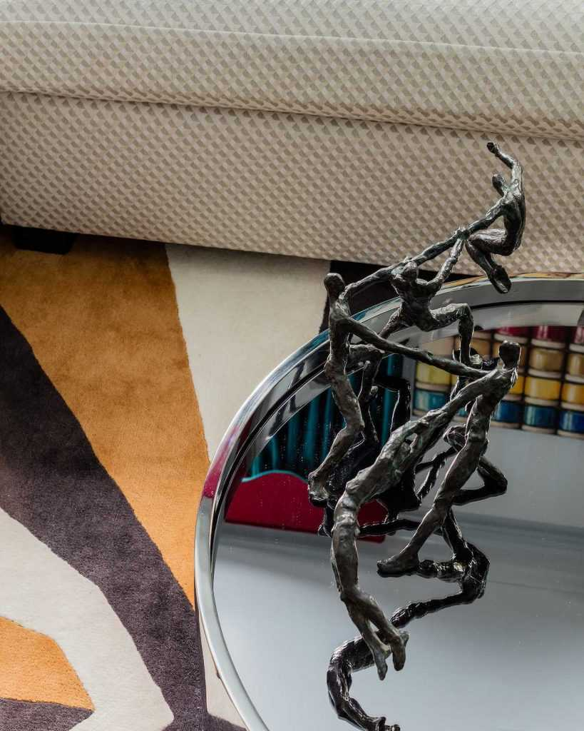 Detail of sculpture atop mirrored coffee table