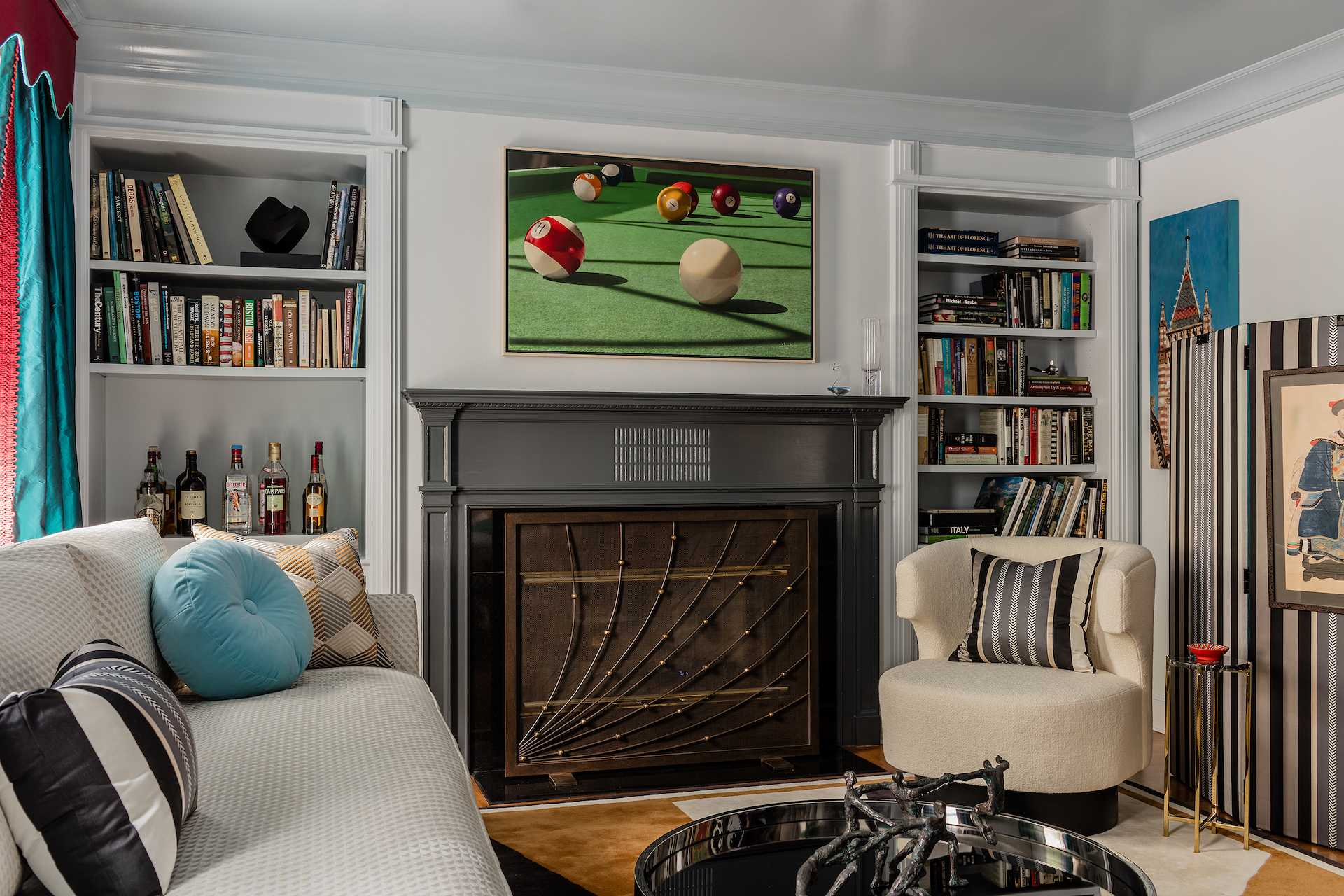 Fireplace and seating arrangement in this Beacon Hill library