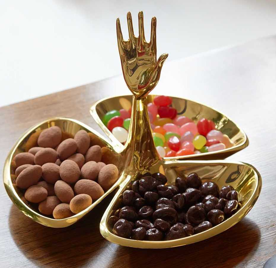 Brass candy dish with three dishes and raised hand that serves as its handle